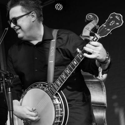 Black and white photo of Ned playing the banjo
