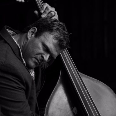 Black and white photo of Daniel Hardin playing the stand up bass